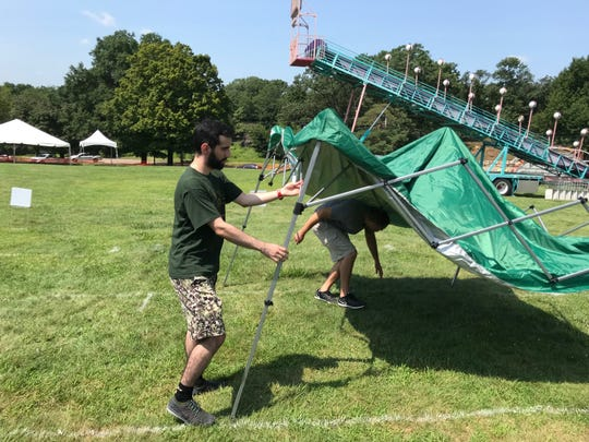 Tents were popping up Wednesday at the Garret Mountain Reservation.
