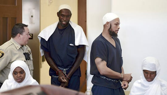 Defendants, from left, Jany Leveille, Lucas Morton, Siraj Wahhaj and Subbannah Wahhaj enter district court in Taos, N.M., for a detention hearing, Monday, Aug. 13, 2018. Several defendants have been charged with child abuse stemming from the alleged neglect of 11 children found living on a squalid compound on the outskirts of tiny Amalia, New Mexico.