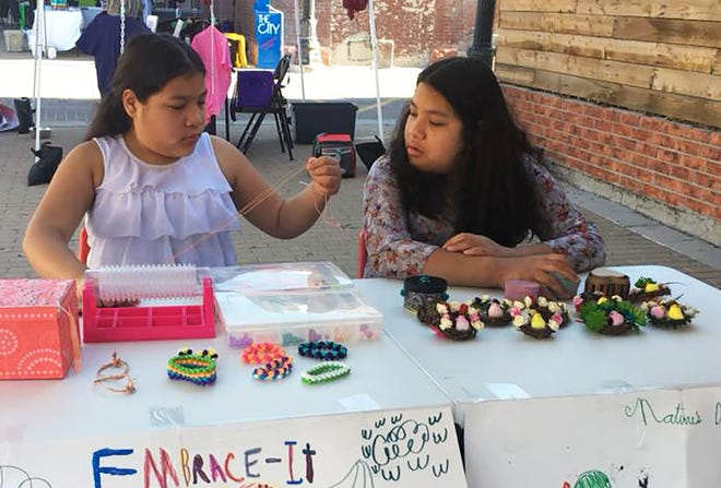 Students in one of the first Camp Innoventure sessions to be held outside of New Mexico sell the handmade products they created for their businesses at the El Paso Downtown Artist and Farmers Market in June. Three Camp Innoventure session were held in the El Paso area this summer, thanks to support from the El Paso-based Success Through Technology Education Foundation and the Hunt Center for Entrepreneurship at New Mexico State University's Arrowhead Center.