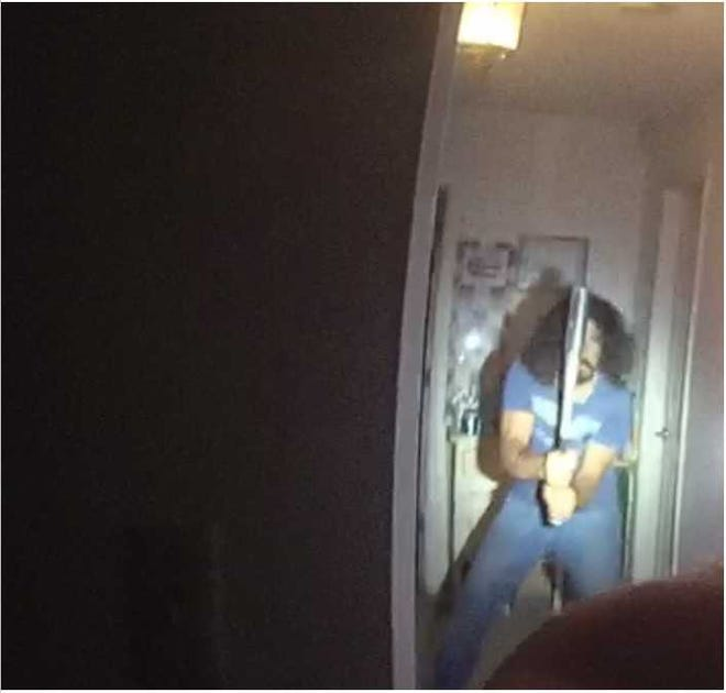 A still from a Las Cruces police officer's lapel camera shows James Bishop wielding an aluminum bat. He charged at police and was fatally shot Friday, Aug. 3, 2018.