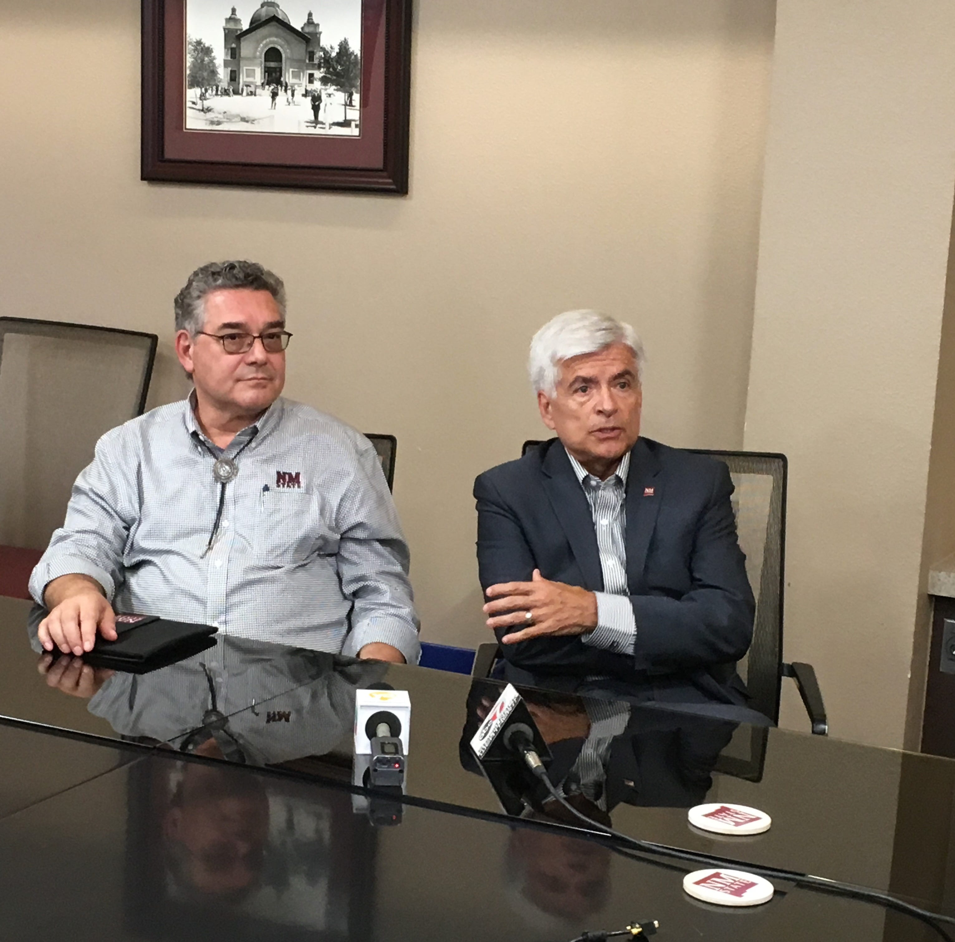 From left, NMSU President John Floros and Chancellor Dan Arvizu speak with reporters at Hadley Hall Wednesday, August 15, 2018.