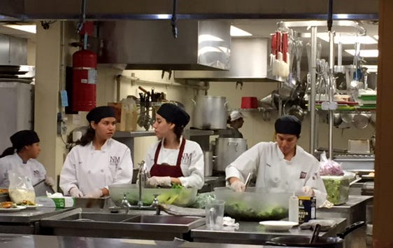 New Mexico State University's Hotel, Restaurant and Tourism Management students prepare a meal for an event in the spring 2018 semester.