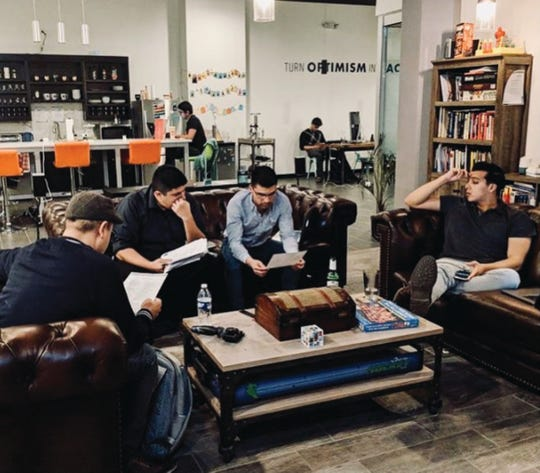 Community members use the common area at CoWork Oasis in El Paso to collaborate on a project. Arrowhead Center has partnered with CoWork Oasis to help expand the regional reach and resources that both programs offer to entrepreneurs and industry in the Borderplex.