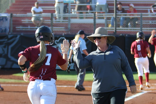 Cat Heifner, right, returns to the New Mexico State softball program as the Aggies' associate head coach.