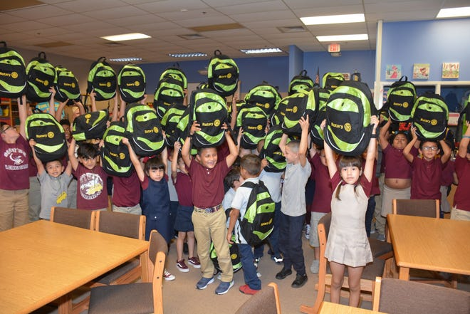 Desert Trails  Elementary School students hold up their back-to-school backpacks, which were presented Monday, Aug. 6 by Anthony Rotary Club and VFW Post 4384.