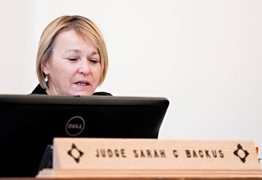 In this Monday, Aug. 13, 2018 photo, District Court Judge Sarah C. Backus presides over the hearing in the Amalia, N.M., desert compound case in Taos, N.M. Backus cleared the way for the release of two men and three women under conditions of house arrest including ankle monitors, despite assertions by prosecutors that the group was training children to use firearms for an anti-government mission and should remain in jail pending trial. Backus' decision to allow the release of an extended family accused of child abuse at a ramshackle desert compound set off a political uproar.