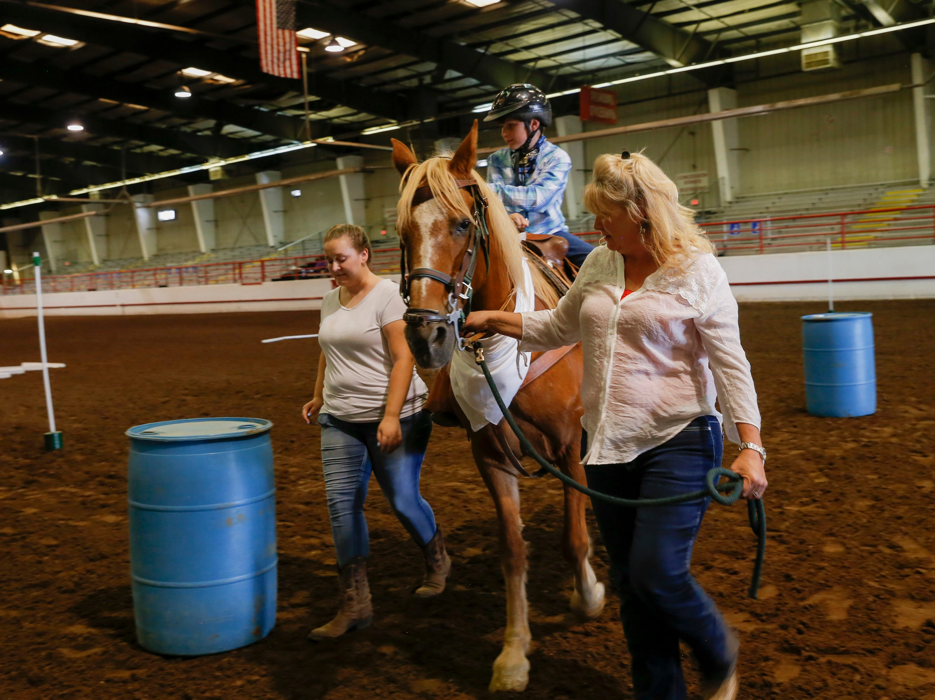Nathanael Muller rides Savvy around barrels Wednesday, Aug. 15. 2018 during an equestrian show for people with disabilities at the San Juan County Fair in Memorial Coliseum at McGee Park in Farmington