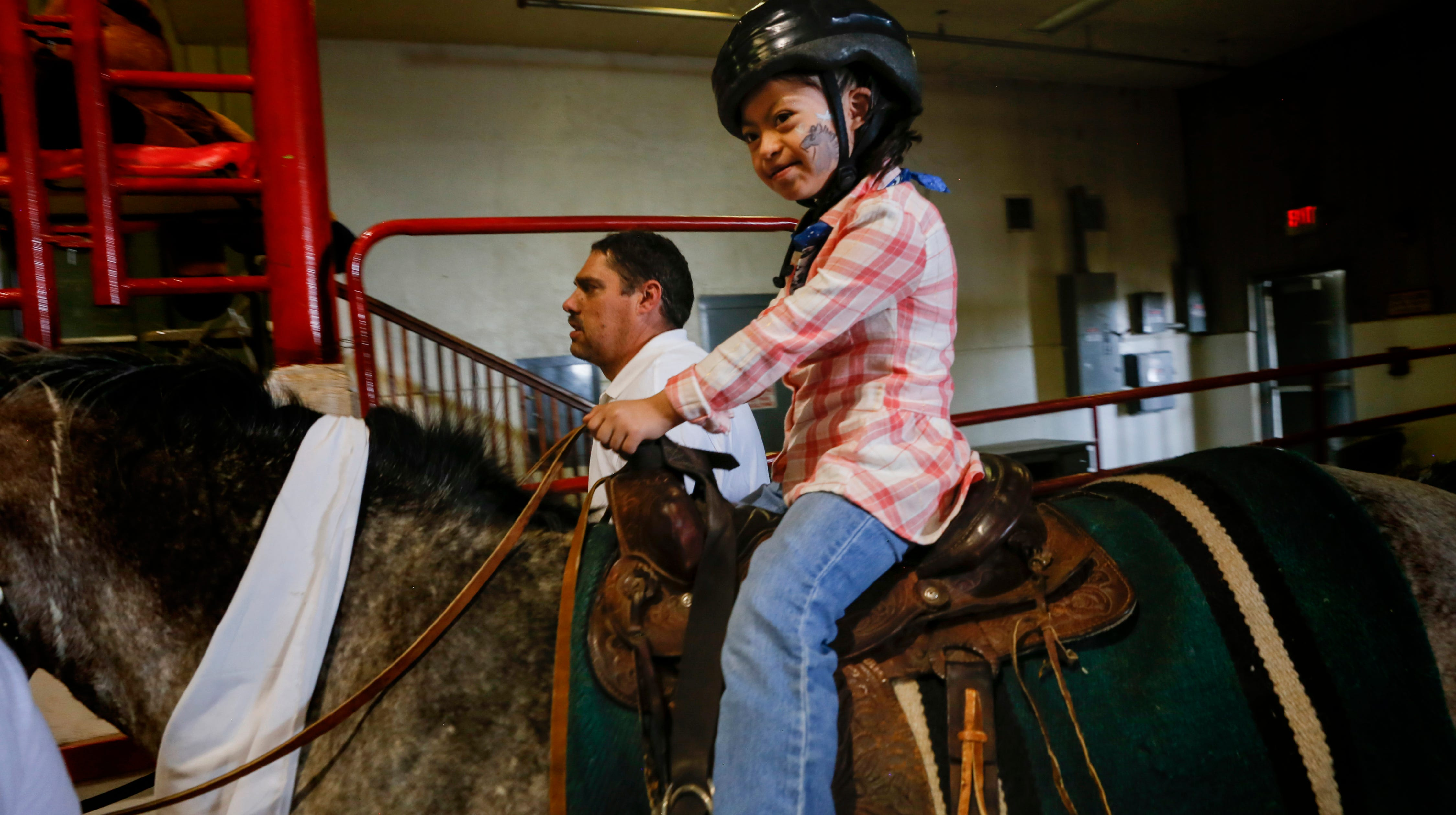 People with disabilities show off horsemanship skills during county fair