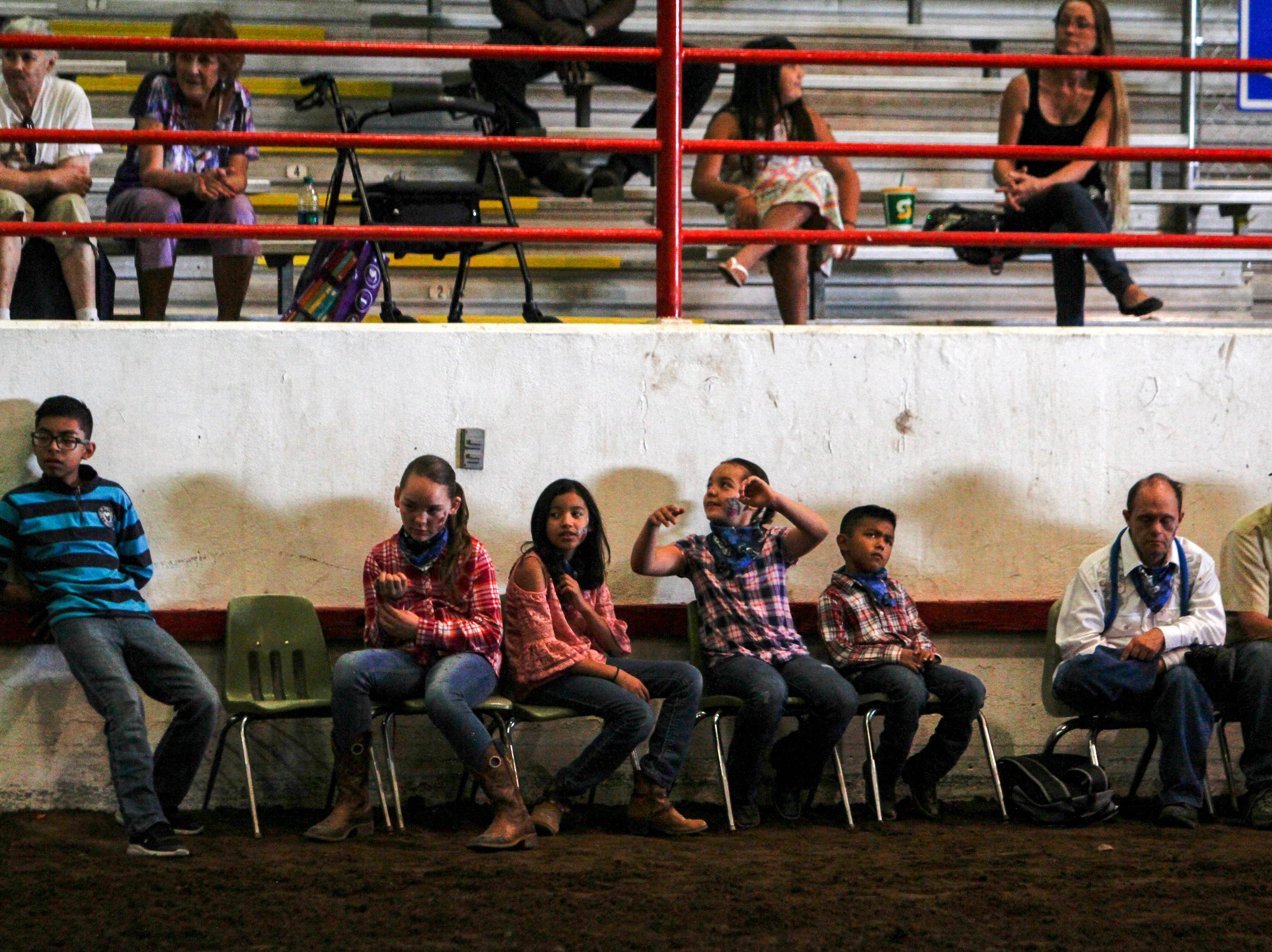 Participants wait their turn to participate in a special horse show, Wednesday, Aug. 15. 2018 at the Main Event an equestrian show for people with special needs at the San Juan County Fair in Memorial Coliseum at McGee Park in Farmington