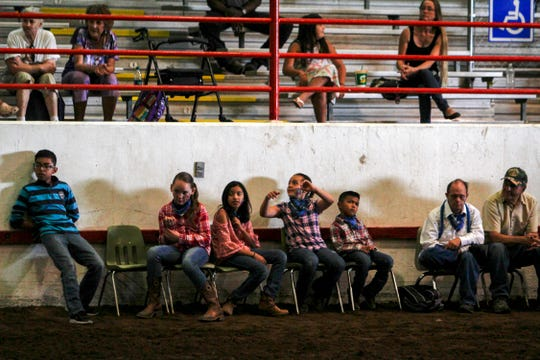 Participants wait their turn to participate in a special horse show held in conjunction with the Mane Event program. This was an equestrian show for people with special needs that took place at the San Juan County Fair in Memorial Coliseum at McGee Park in Farmington.