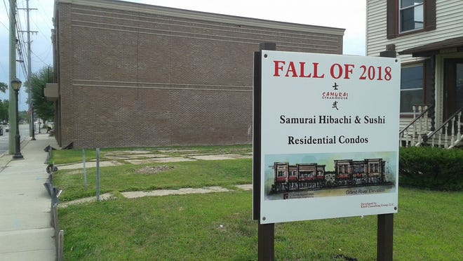 A sign shows where developers plan to build Samurai Steakhouse along Grand River Avenue in downtown Farmington. The building in the background is Samurai Hibachi & Sushi, which will is set to open this fall.