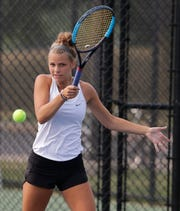 Oshkoh North's Courtney Day returns the ball during singles play at the Oshkosh North Invitational on Aug. 15.
