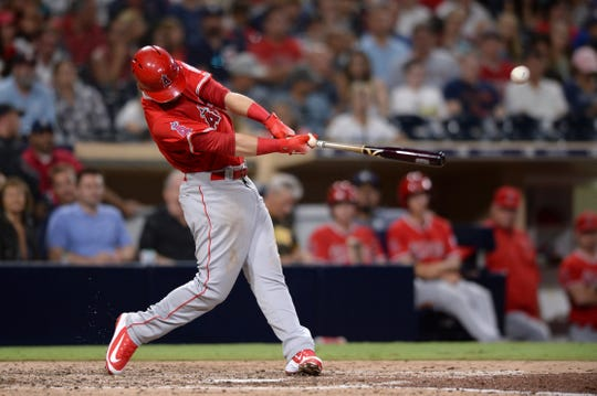 Los Angeles Angels' Taylor Ward singles during the sixth inning of a baseball game against the San Diego Padres Tuesday, Aug. 14, 2018, in San Diego. (AP Photo/Orlando Ramirez)