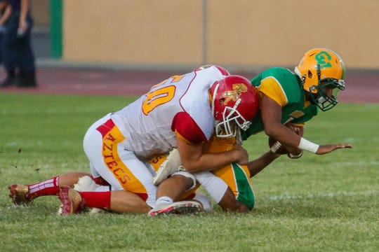 Palm Desert linebacker Jack Queenen tackles Coachella Valley quarterback Armando Deniz on in 2017.