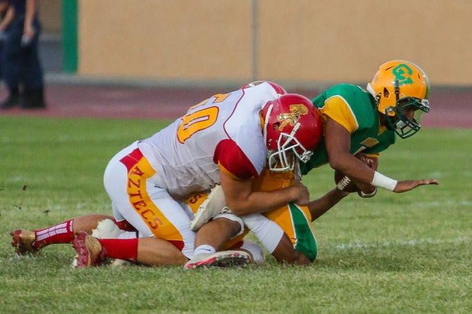 Palm Desert linebacker Jack Queenen tackles Coachella Valley quarterback Armando Deniz on in 2017.