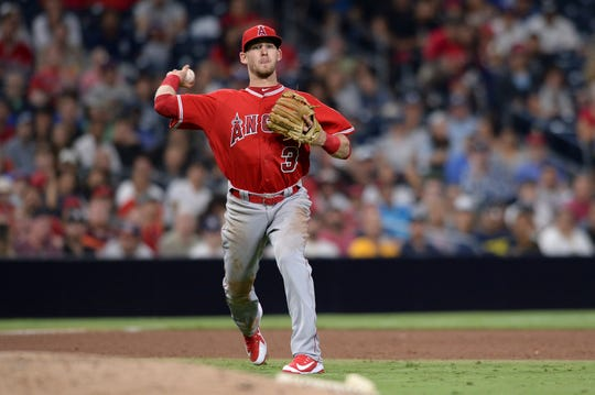 Los Angeles Angels third baseman Taylor Ward throws to first base on a ground out by San Diego Padres' Freddy Galvis during the sixth inning of a baseball game Tuesday, Aug. 14, 2018, in San Diego. (AP Photo/Orlando Ramirez)