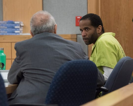 Robert Howard, the suspect in the death of 12-year-old Naomi Jones, talks Wednesday with attorney Spiro Kypreos during a hearing before Circuit Judge Gary Bergosh.