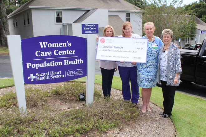 Participating in the check presentation for proceeds from the Power of E3 Conference, from left, are Debb Alonso, Senior Services coordinator; Julie Loftus, Sacred Heart Women's Care Center charge nurse; Dr. Suzanne Bush,  Women's Care Center medical director; and Annalee Leonard, president of Mainstay Financial Corp.