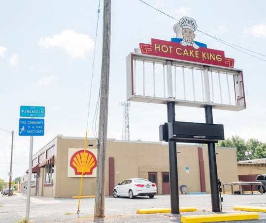 """According to Uncle Billy Boyette, the iconic """"Hot Cake King"""" sign outside of his new Uncle Billy's Antique Mall in the old Oscar's Restaurant building on Cervantes Street has found a new home at the Brew Ha Ha restaurant.  Wednesday, August 15, 2018."""