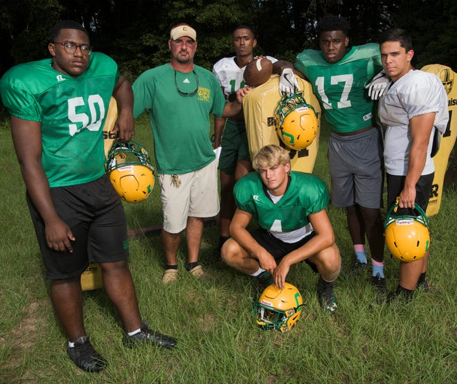 Catholic High Football Coach, Matt Adams, 2nd from left, is expecting big things from his players, Tryee Dunn, A.J. Joseph, Bryan Mixon, Jakobi Jackson, and Seth Wilson this season.