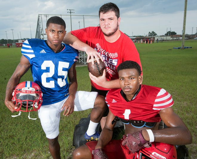 The Pine Forest High School coaching staff is expecting big things from team leaders (left to right) Anwar Lewis, John Gill, and Martin Lewis this football season.