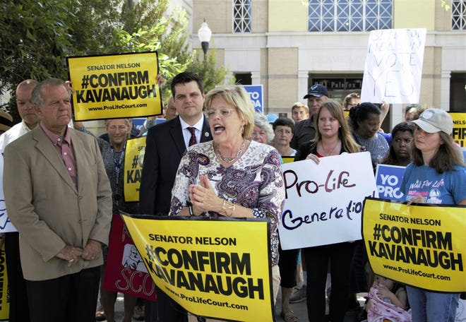 Jill Stanek, national campaign chair for the Susan B. Anthony List, speaks Wednesday at a press conference in Pensacola urging Sen. Bill Nelson to confirm Brett Kavanaugh to the U.S. Supreme Court as U.S. Rep. Matt Gaetz, state Sen. Doug Broxson and others listen.
