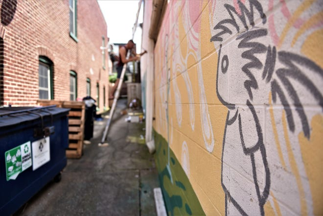 "The entrance to the alley behind 17 Lincoln Square where the ""brain forest"" mural is in the process of being painted."
