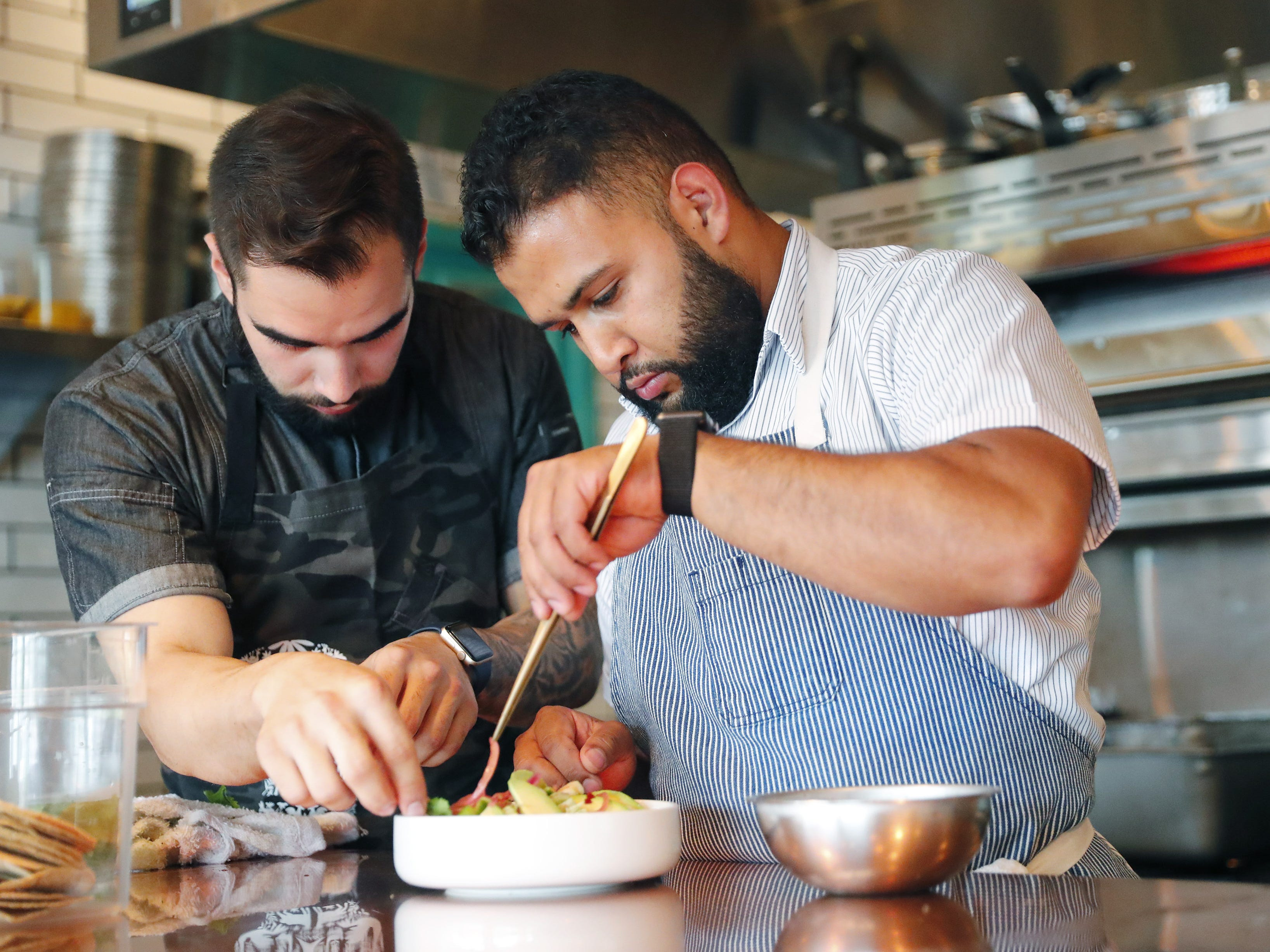 Chefs Roberto Centeno (left) and Rene Andrade prepare ceviche at Ghost Ranch in Tempe, Ariz. August 14, 2018.