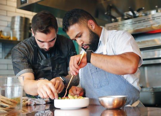 Chefs Roberto Centeno (left) and Rene Andrade prepare ceviche at Ghost Ranch in Tempe, Ariz. August 14, 2018.