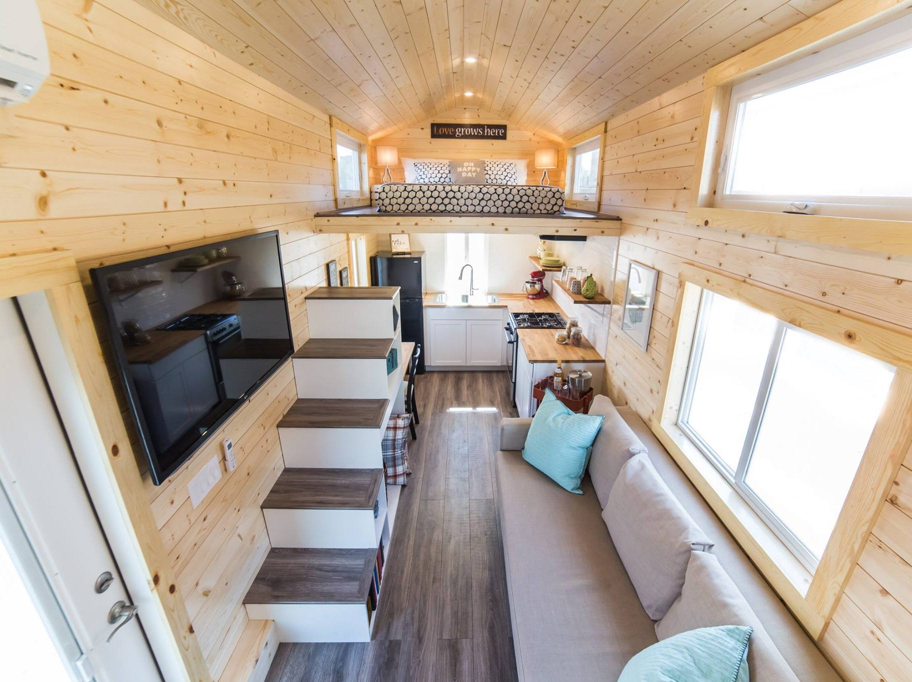 An aerial view from one end of a tiny home to another.
