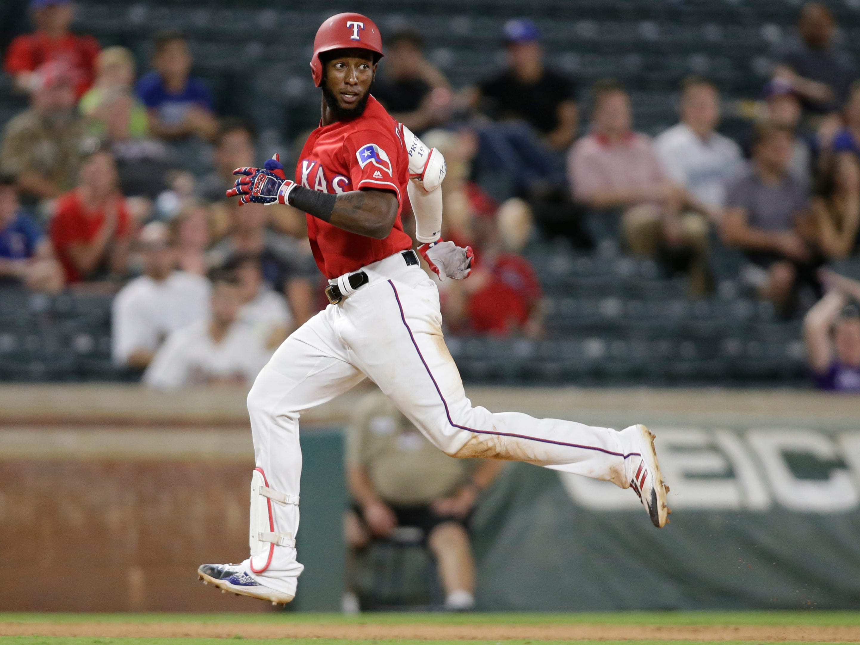 Aug 14, 2018: Texas Rangers third baseman Jurickson Profar (19) runs to third base with a triple in the ninth inning against the Arizona Diamondbacks at Globe Life Park in Arlington.