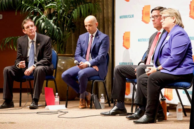 From left, gubernatorial candidates Ken Bennett, David Garcia, state Sen. Steve Farley and Kelly Fryer listen to a question being read at the March for Our Lives town hall on gun violence. Incumbent Gov. Doug Ducey did not attend.