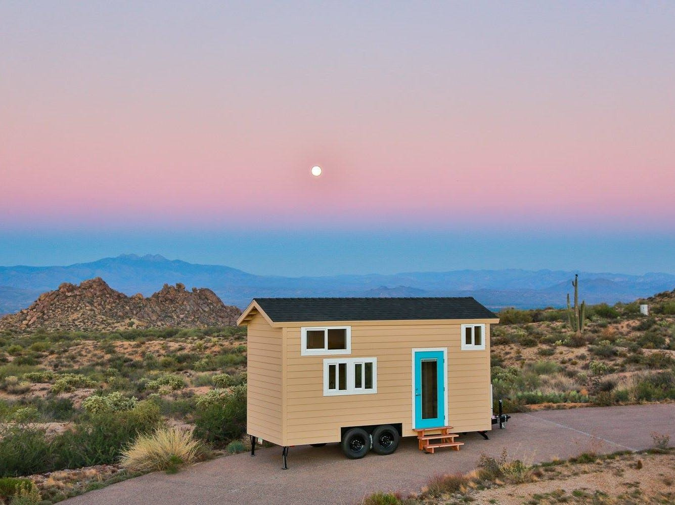 Another view of a tiny home with the Arizona sunset in the background.