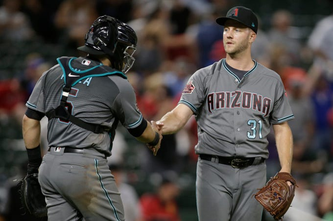 Aug 14, 2018: Arizona Diamondbacks catcher Alex Avila (5) congratulates relief pitcher Brad Boxberger (31) after defeating the Texas Rangers at Globe Life Park in Arlington.