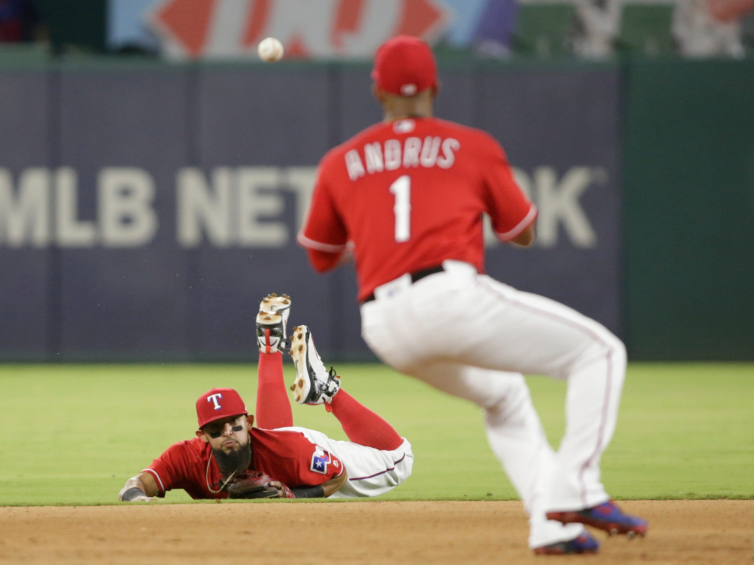 Aug 14, 2018:Texas Rangers second baseman Rougned Odor (12) throws to shortstop Elvis Andrus (1) for a force out in the eighth inning against the Arizona Diamondbacks  at Globe Life Park in Arlington.