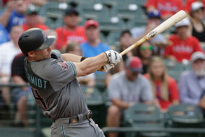 Aug 14, 2018: Arizona Diamondbacks designated hitter Paul Goldschmidt (44) hits a home run in the first inning against the Texas Rangers at Globe Life Park in Arlington.