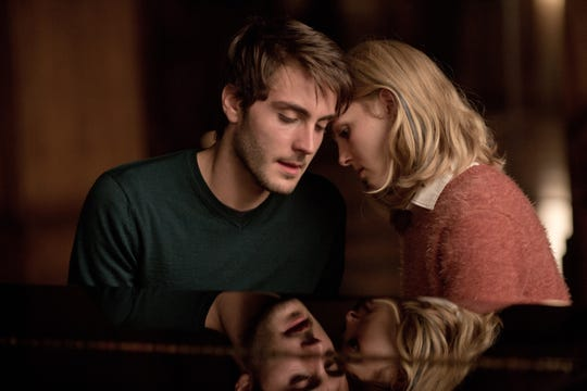 """Jules (Noah Silver) and Kit (AnnaSophia Robb) grow closer over music lessons in """"Down a Dark Hall."""""""