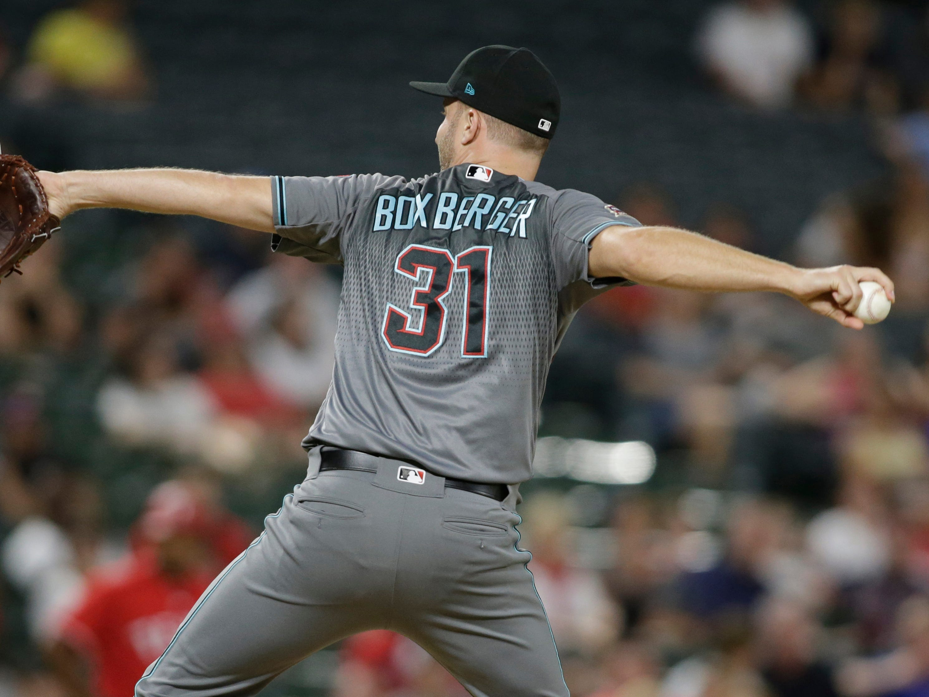 Aug 14, 2018: Arizona Diamondbacks relief pitcher Brad Boxberger (31) throws a pitch in the ninth inning against the Texas Rangers at Globe Life Park in Arlington.