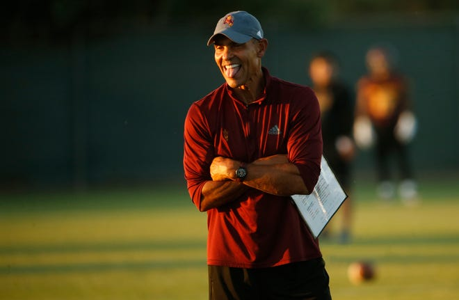 ASU head coach Herm Edwards sticks out his tongue during practice at Kajikawa Practice Fields in Tempe, Ariz. on Aug. 3, 2018.