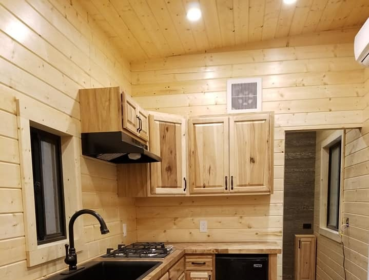 A view looking into another tiny home's kitchen.