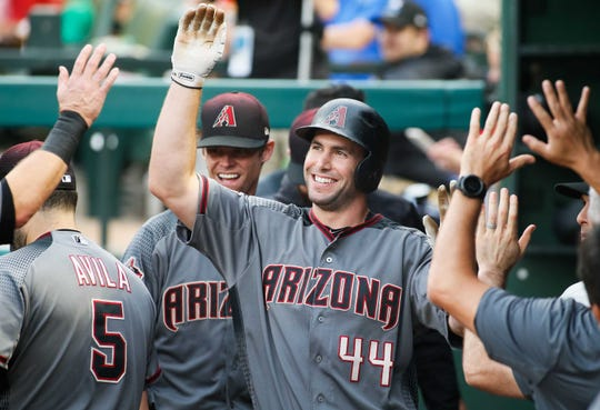 Diamondbacks first baseman celebrates with his teammates after scoring against the Rangers during a game Aug. 13 at Globe Life Park.