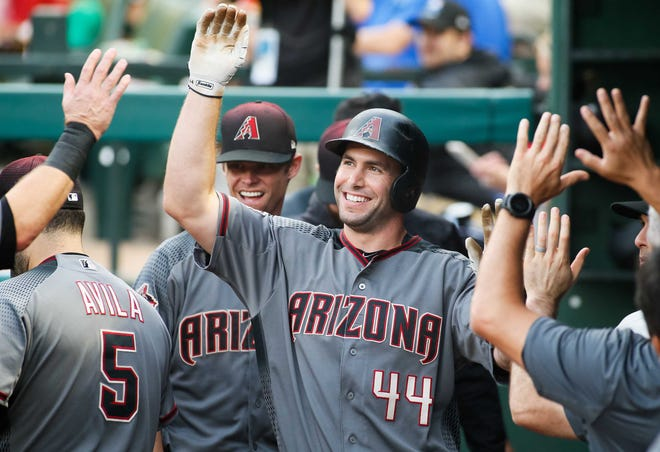 Aug 13, 2018; Arlington, TX, USA; Arizona Diamondbacks first baseman Paul Goldschmidt (44) is greeted in the dugout after scoring in the first inning against the Texas Rangers at Globe Life Park in Arlington.