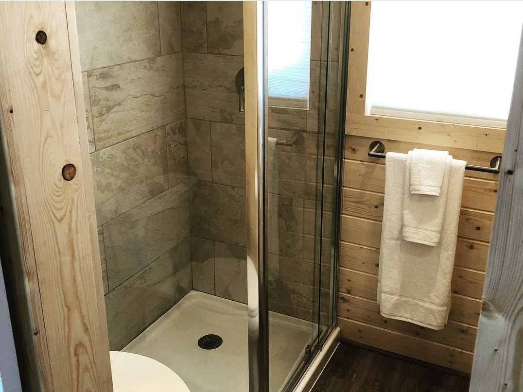 A shower inside another tiny home.