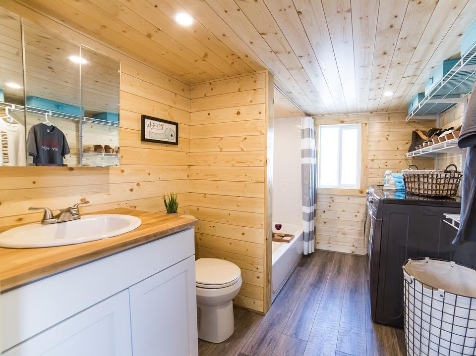 The bathroom inside the tiny home, which doubles as the washroom.