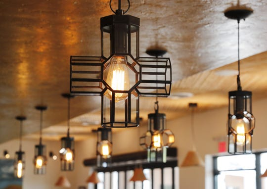 Wrought-iron light fixtures inside Ghost Ranch in Tempe.