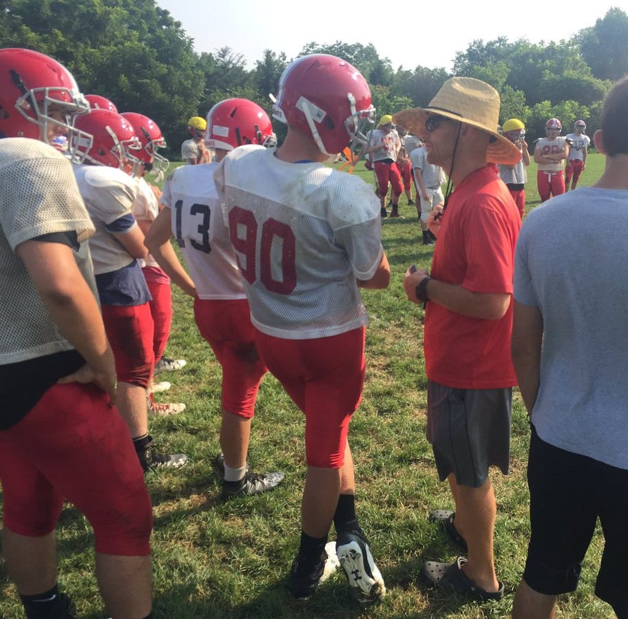 Annville-Cleona football coach Matt Gingrich converses with one of his players during a Wednesday morning practice session. A-C opens the 2018 season on Friday vs. Milton Hershey and has hopes of competing for the Section 3 title and a District 3 playoff berth.