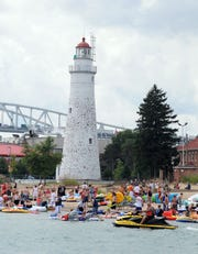 Participants get into the water in front of the Fort Gratiot Light House in 2011.