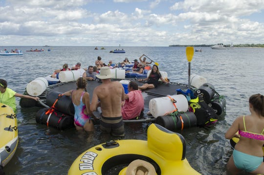 A makeshift raft made from a backyard trampoline launches  during the 2016 Float Down at Lighthouse Beach in Port Huron.