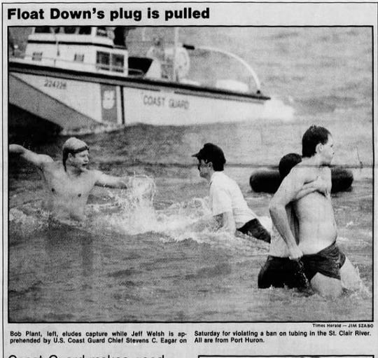 Coast Guard members remove rebel rafters after outlawing rafting between Port Huron and Marysville during the 1987 Float Down.