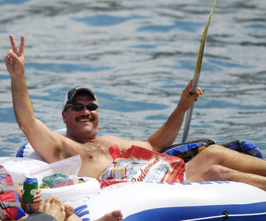 Jim Feher, of Port Huron, enjoys the sun and fun of the 2013 Float Down.